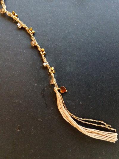 Bracciale ad un filo con pietre dorate e cipria