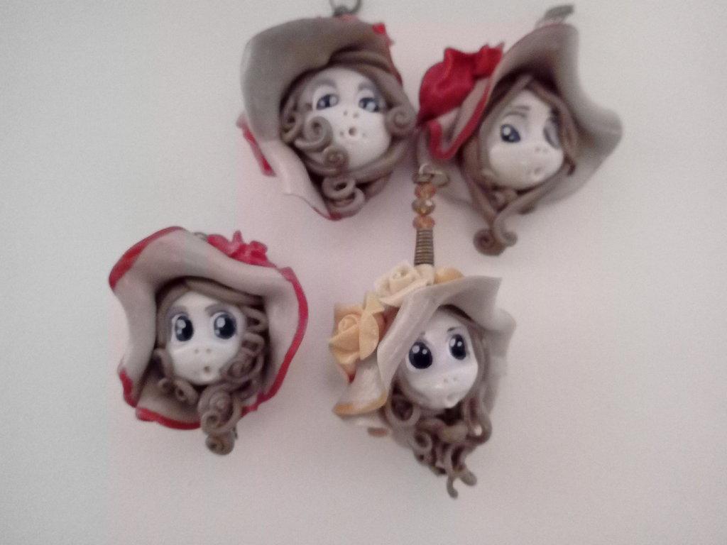 Ciondolo volto di bambola