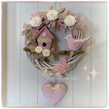 Fiocco nascita in viticcio con uccellino,nido e cuore rosa
