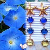 Orecchini pendenti con perni in zama a stella e cristalli multicolori