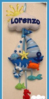 Fiocco nascita barca a vela con animali marini