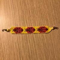 Schema braccialetto da realizzare su telaio - coccinelle