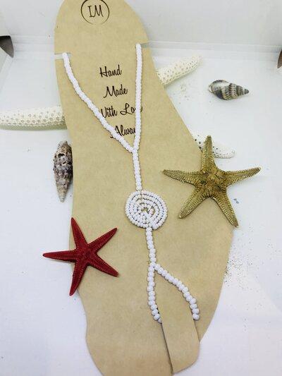 Cavigliera etnica di perline con anello dito.