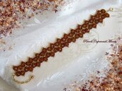 Bracciale arancione melange al chiacchierino, cristalli color topazio, perline dorate