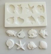 Multistampo 8 soggetti marini chiudipacco da circa 3,5 cm.