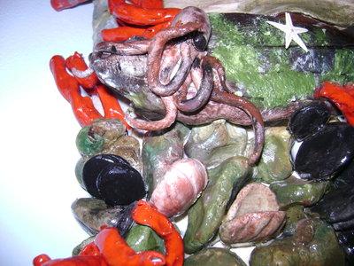 tegola con corallo e veliero