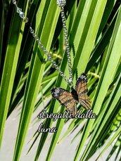 Collana ciondolo farfalla arancione ,nera  e cristalli