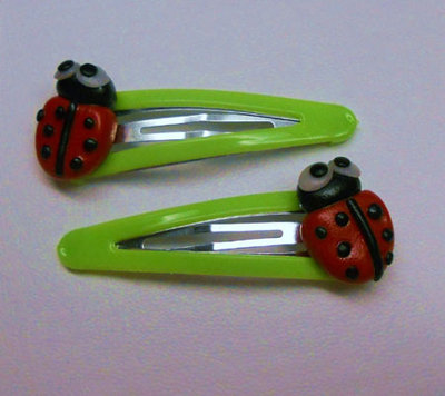 "MOLLETTINE FERMACAPELLI IN FIMO ""COCCINELLE"""