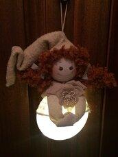 Bambola folletta luminosa