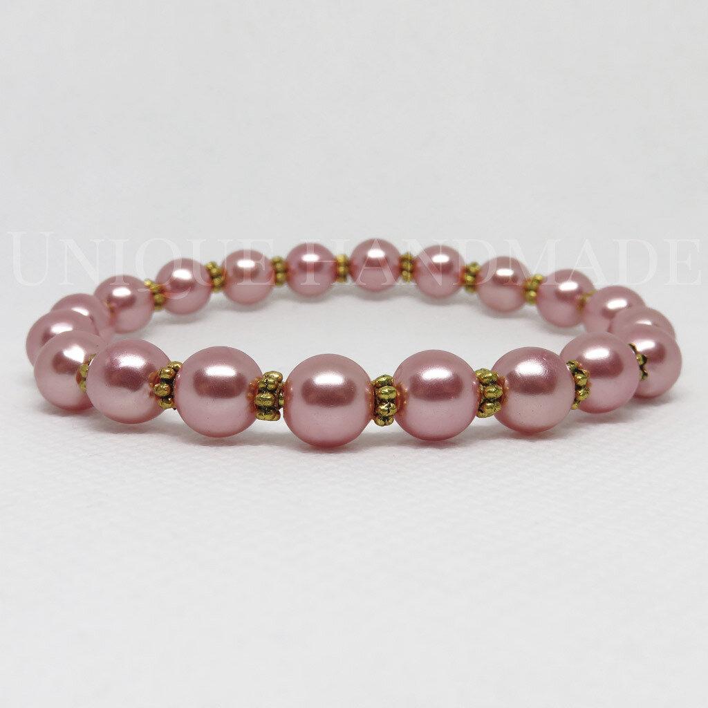 Bracciale elastico di perle rosa