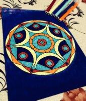 Mandala su sfondo blu