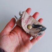 Porta cuffie in cotone con bottone a pressione