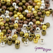 Lotto 10 gr. perline distanziatrici 3 mm. colori mix