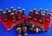 12 Bottiglie di Coca-Cola in miniatura