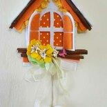Casetta con davanzale fiorito