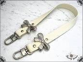 manico per borsa 60 cm. in similpelle colore crema con 2 fiocchi strass.