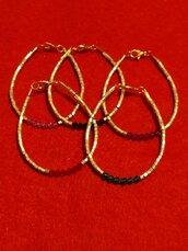 Bracciali con perline oro e cristalli