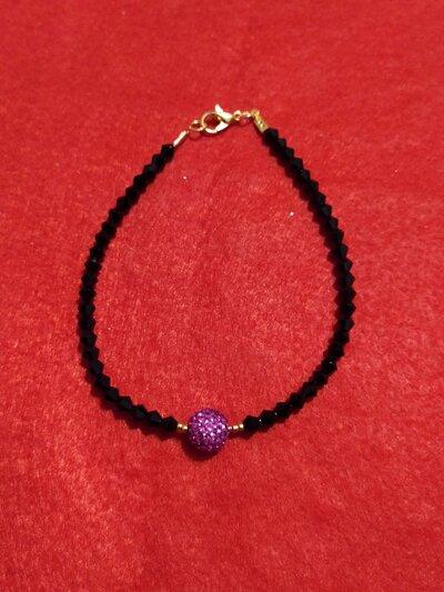 Bracciale con cristalli neri e con perla rosa in Swarovski