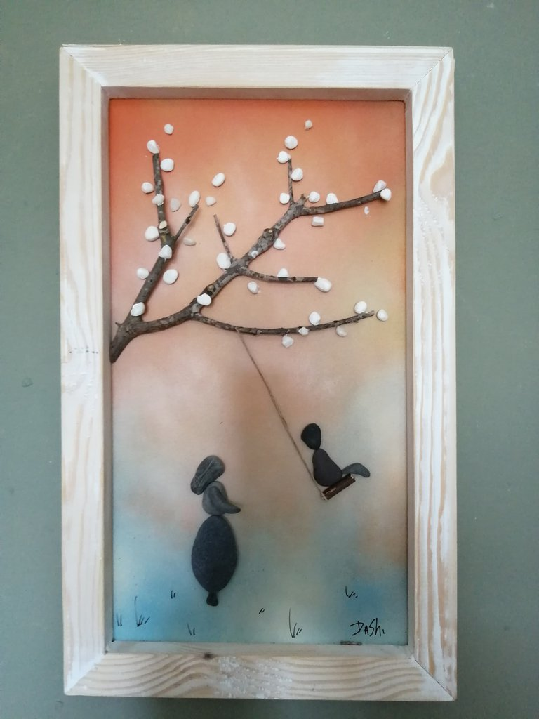 bambina in altalena,quadro in relievo di sassi
