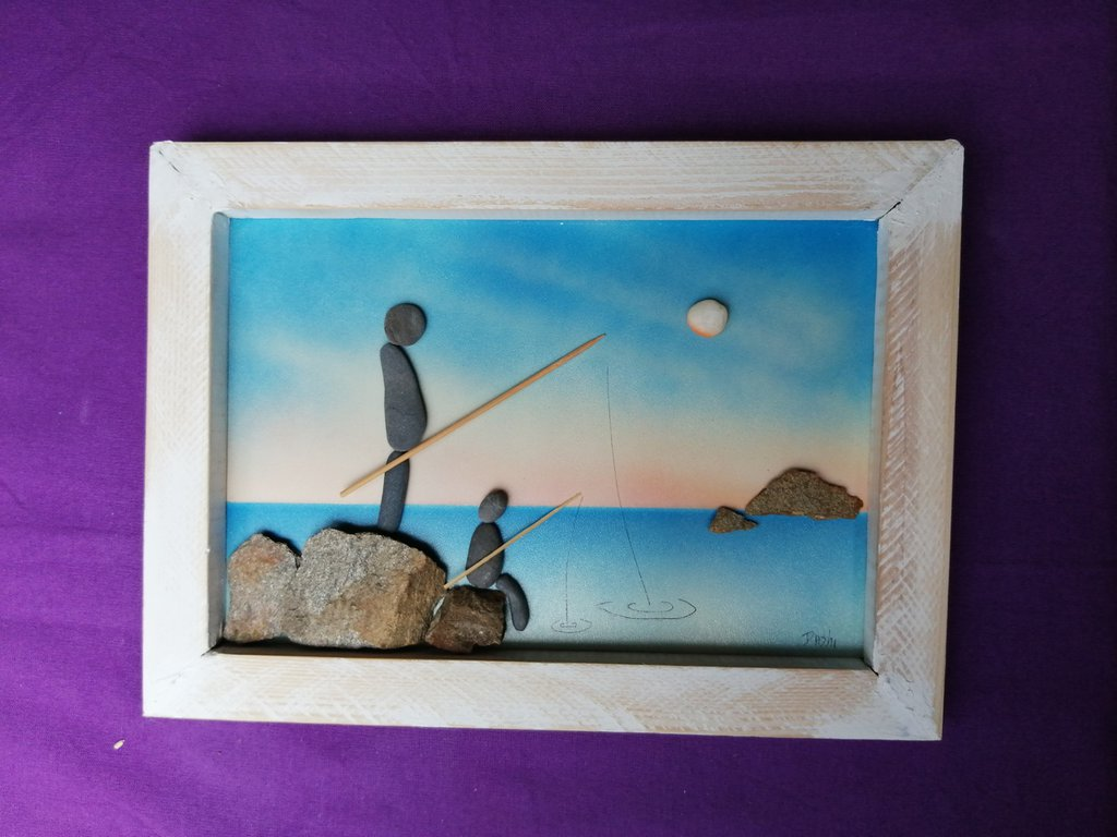 padre e figlio pesando,quadro realizato in relievo con sassi
