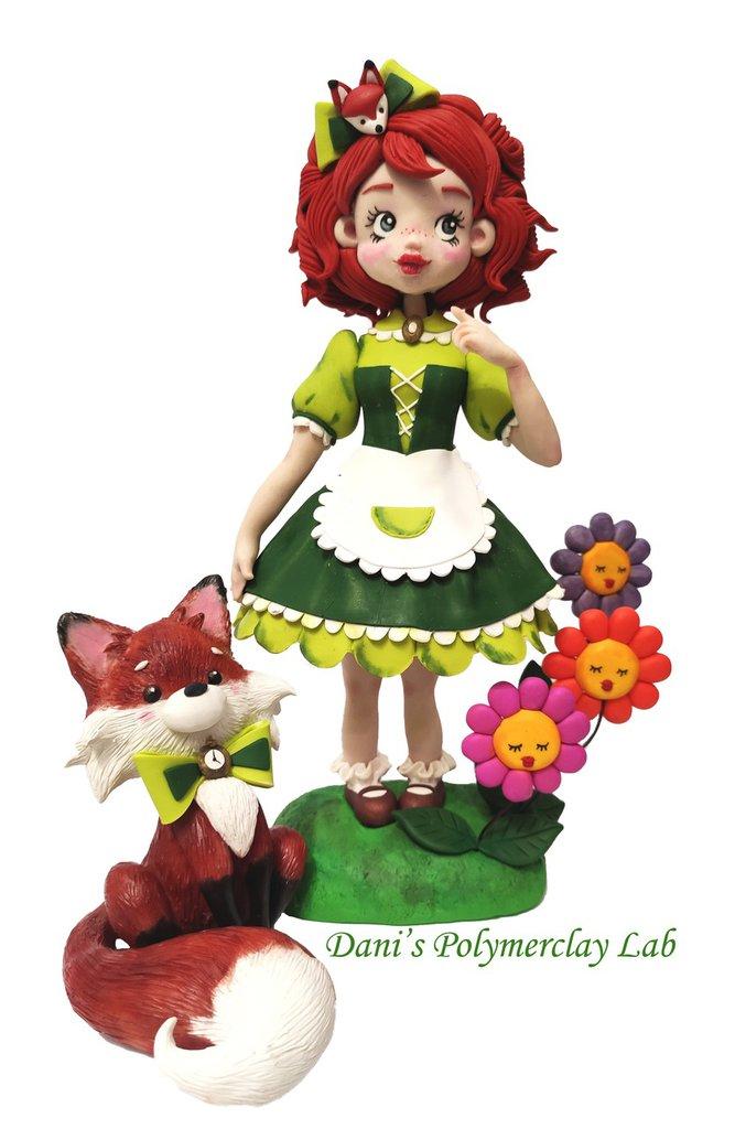 Coppia di statuine Alice e la volpe