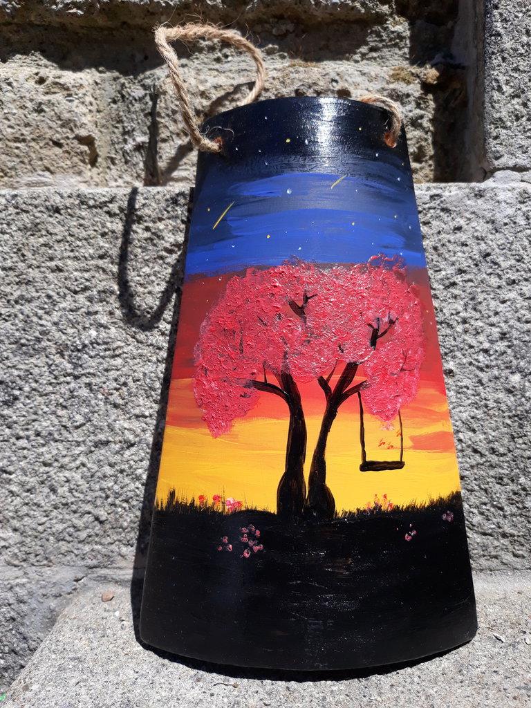 tegola in terracotta tramonto ed altalena