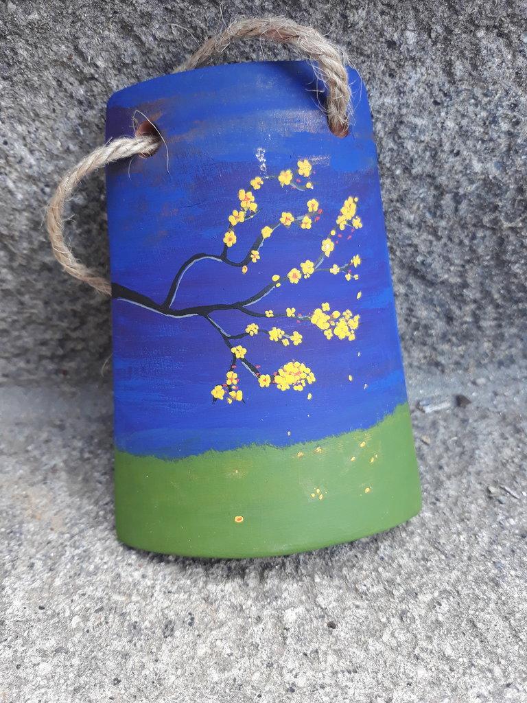 Piccola tegola albero fiorito