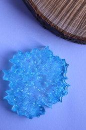 sottobicchiere in resina effetti iridescenti.