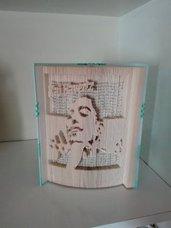 Riciclo libri scultura