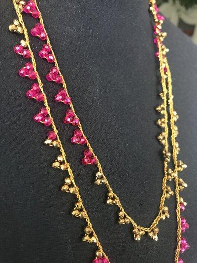 Collana handmade con cristalli oro e fucsia