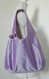 Borsa a spalla donna in tessuto shantung di seta lilla con fiocco di piallettes viola.