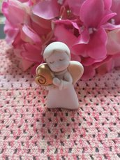 Angioletto - angelo  in resina con cuore oro