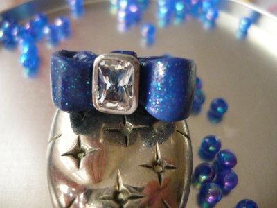 Elegant blue bow ring