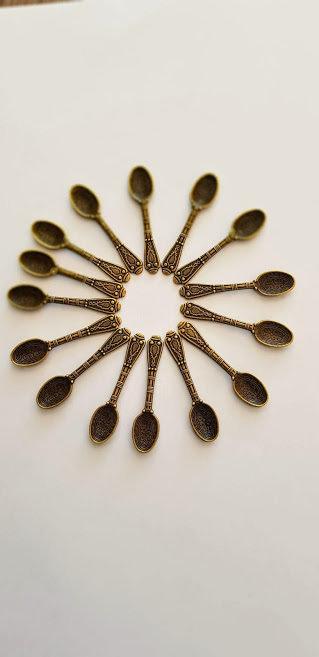 cucchiaio metallo bronzato