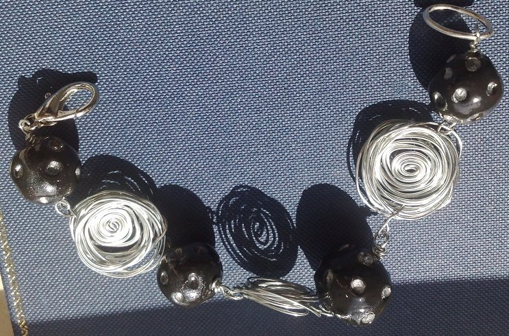 bracciale con rose in acciaio