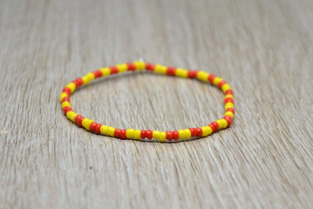 bracciale elastico perline uomo donna giallo rosso
