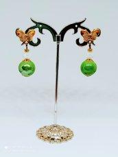Orecchini farfalle dorate, mezzi cristalli e perle in ceramica