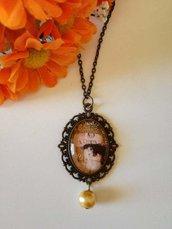Maternità di Klimt collana girocollo con ciondolo a cerchio, immagine dedicata alla splendida arte di klimt e perlina dorata