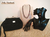 Set pochette clic clac donna in cordino nero glitterato con gioielli tessili abbinati