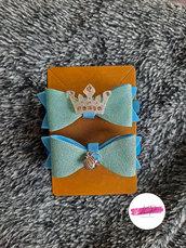 Coppia elastici per capelli con fiocco glitter e applique coroncina con charm