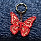 Farfalla portachiavi in pelle con perline in vetro e cordoncino macramè