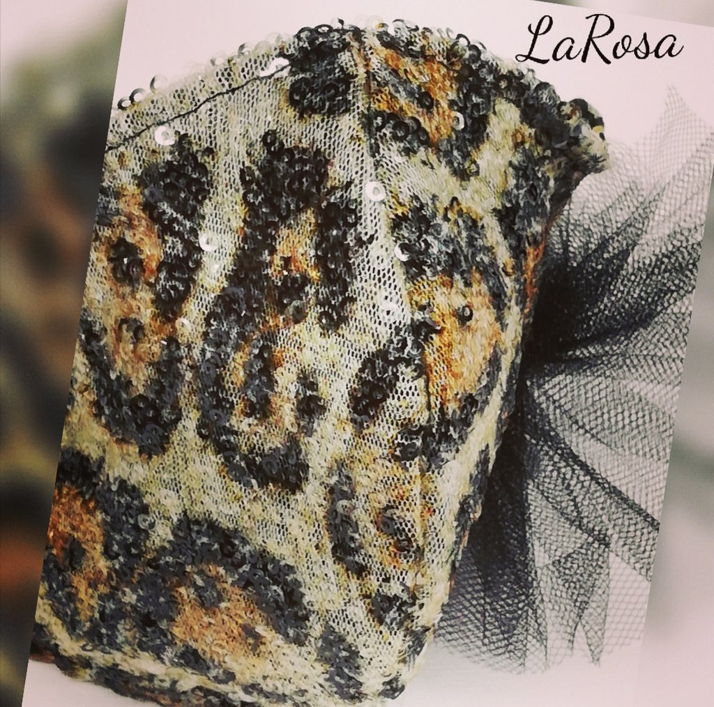 Mascherina moda  in tessuto  paillettes  leopardata