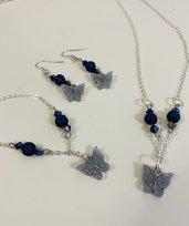 Parure con pietre blu e farfalla argento