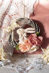 Ghirlanda con coniglio e fiori