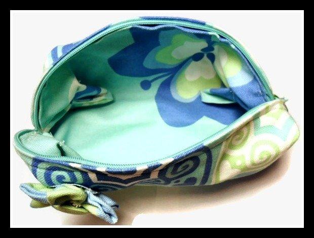 Pochette verde acqua con fiore