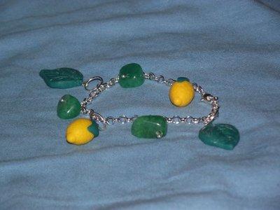 Bracciale limoni con foglioline e pietre
