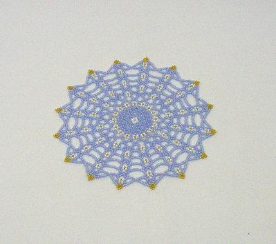Centrino di perline azzurro