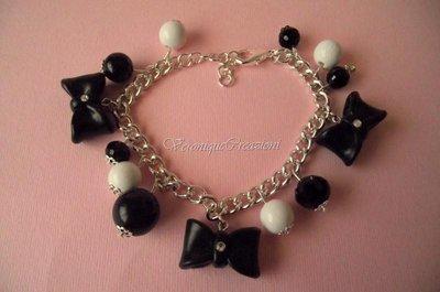 Braccialetto fiocchetti e perle
