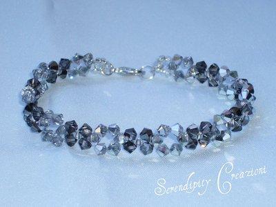 Braccialetto Swarovski tonalità del grigio-argento