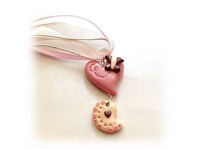 Collana farfalla su cuore pink- fimo